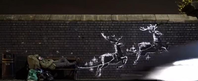 Стенна рисунка на анонимния британски стрийт художник Банкси на бездомник,